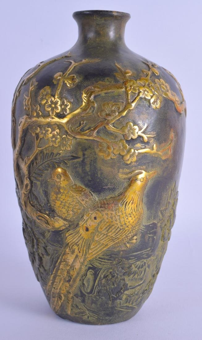 A CHINESE BRONZE VASE 20th Century, overlaid with vines
