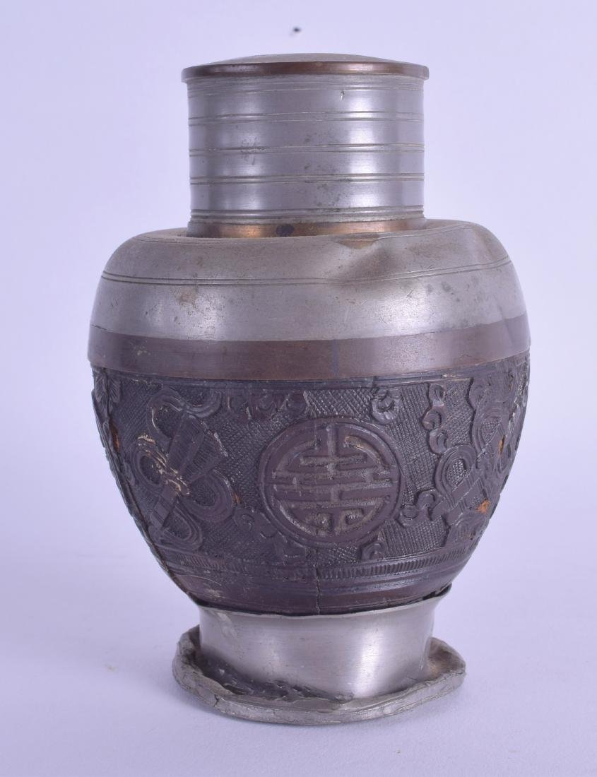 A 19TH CENTURY CHINESE CARVED COCONUT AND AND PEWTER