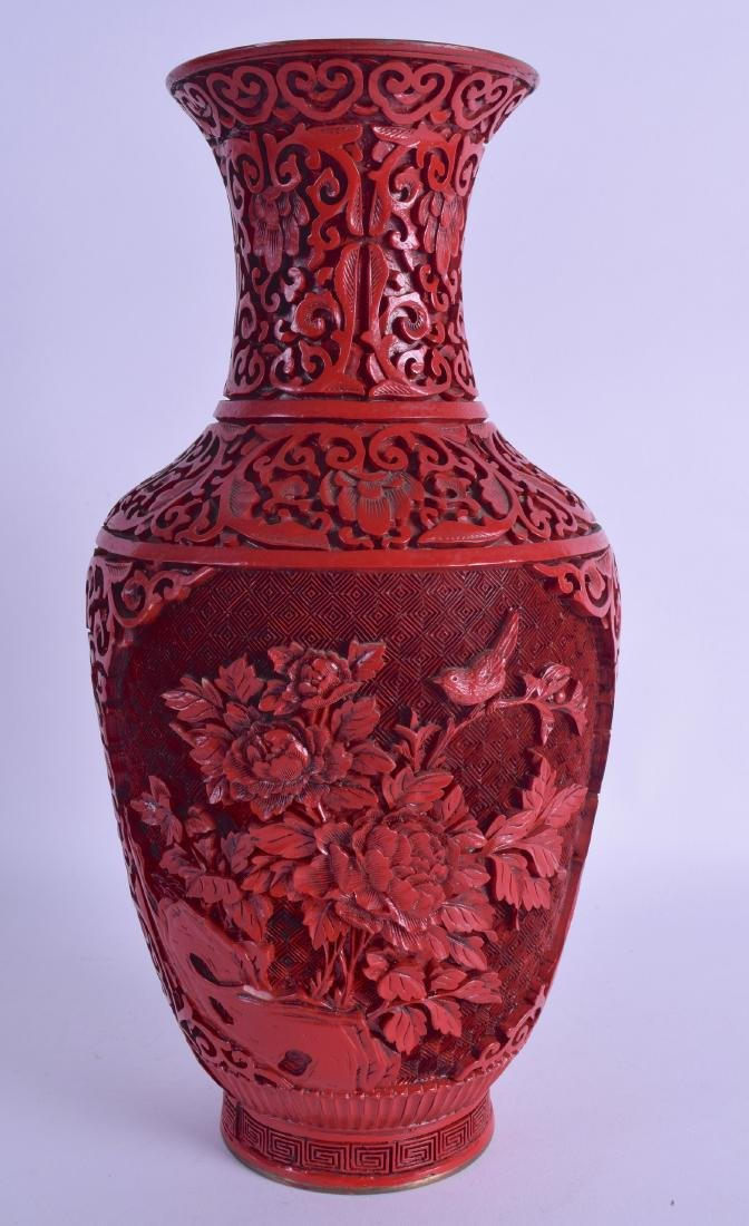 AN EARLY 20TH CENTURY CHINESE CINNABAR LACQUER VASE