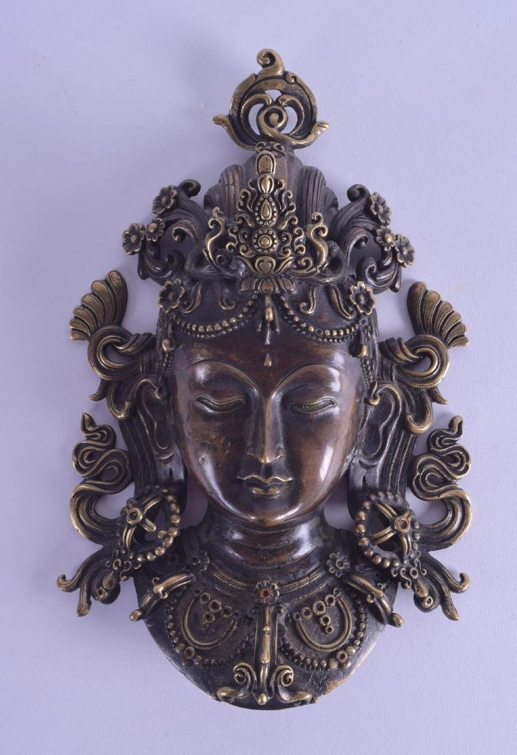 A 19TH CENTURY CHINESE SINO TIBETAN BRONSE MASK HEAD