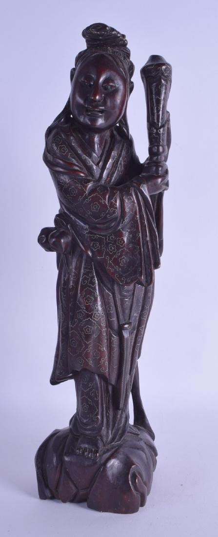 A 19TH CENTURY CHINESE SILVER INLAID HARDWOOD FIGURE OF