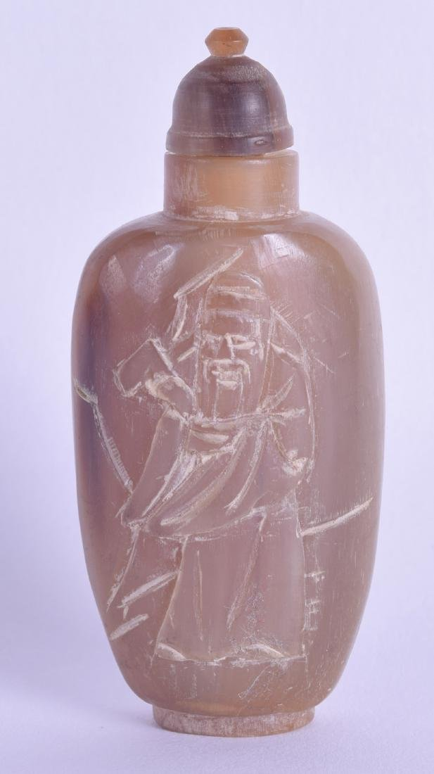 A CHINESE CARVED BUFFALO HORN SNUFF BOTTLE AND STOPPER