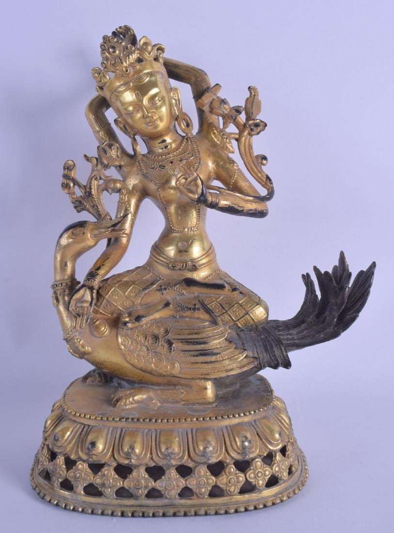 A CHINESE SINO TIBETAN GILT BRONZE FIGURE OF A FEMALE