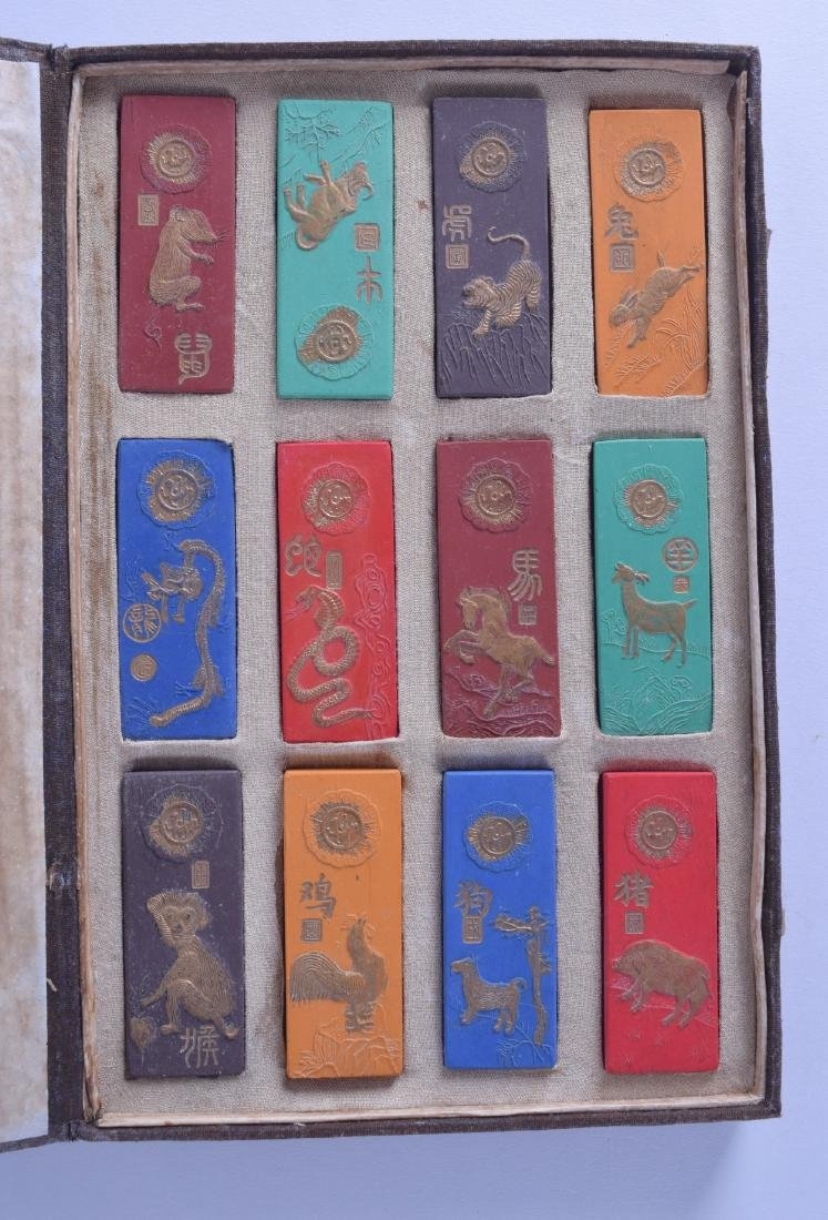 A CASED SET OF TWELVE CHINESE INK BLOCKS decorated with
