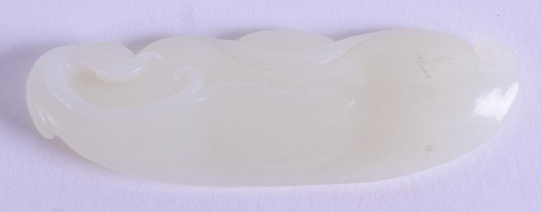A CHINESE CARVED GREENISH WHITE JADE FLORAL AMULET of