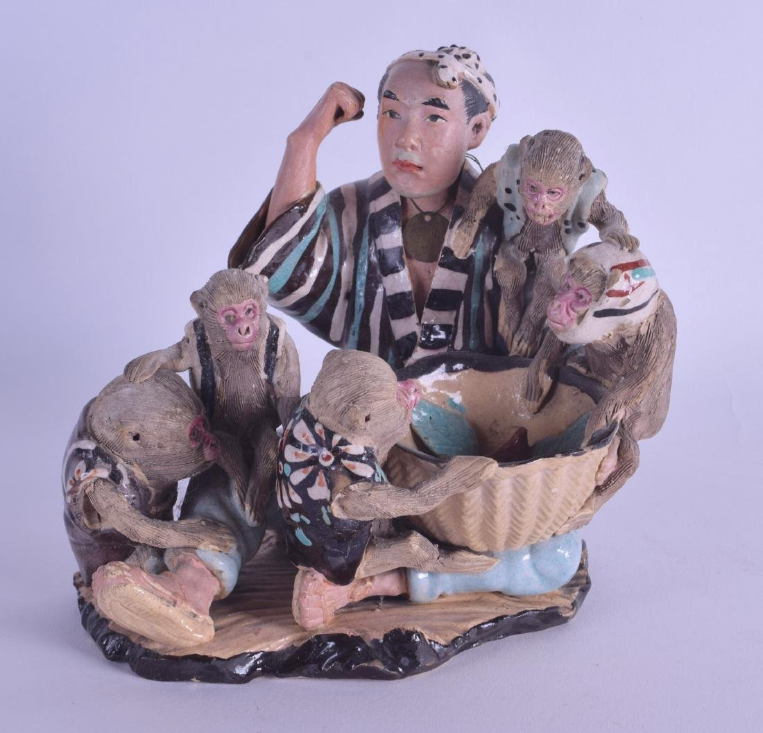 AN EARLY 20TH CENTURY JAPANESE SUMIDA POTTERY FIGURE OF