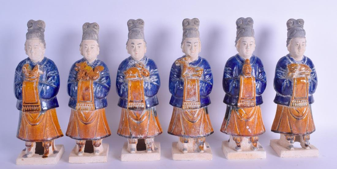 A SET OF SIX CHINESE TANG DYNASTY STYLE POTTERY FIGURES