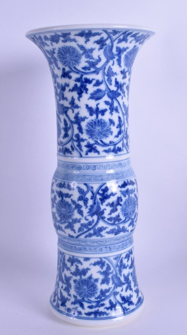 A CHINESE BLUE AND WHITE GU SHAPED BEAKER VASE probably