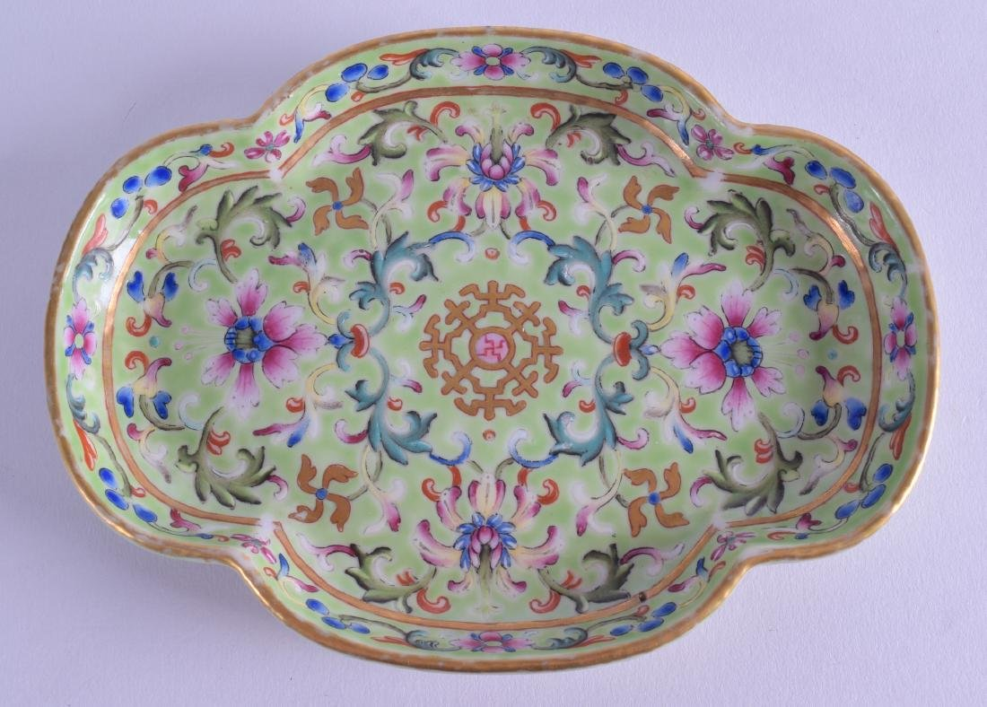 A CHINESE FAMILLE ROSE LIME GROUND PORCELAIN LOBED DISH