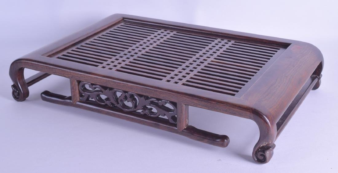 AN UNUSUAL CHINESE CARVED HARDWOOD SCHOLARS TABLE with