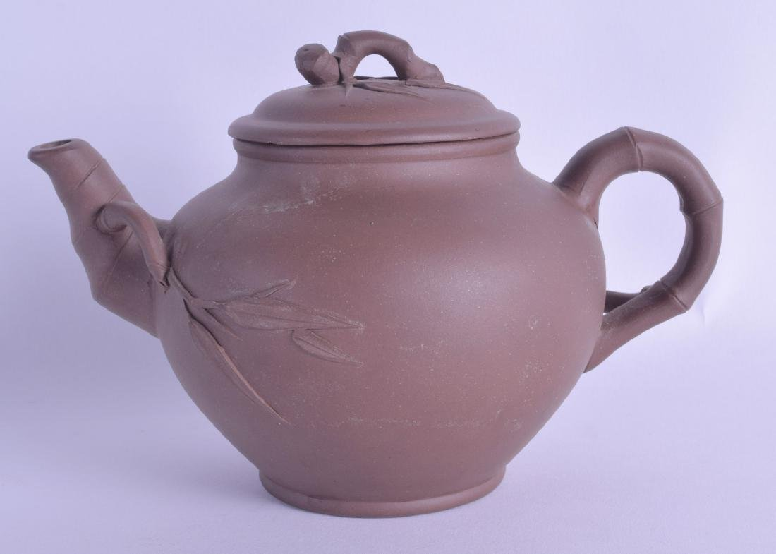 A CHINESE YIXING POTTERY TEAPOT AND COVER with faint