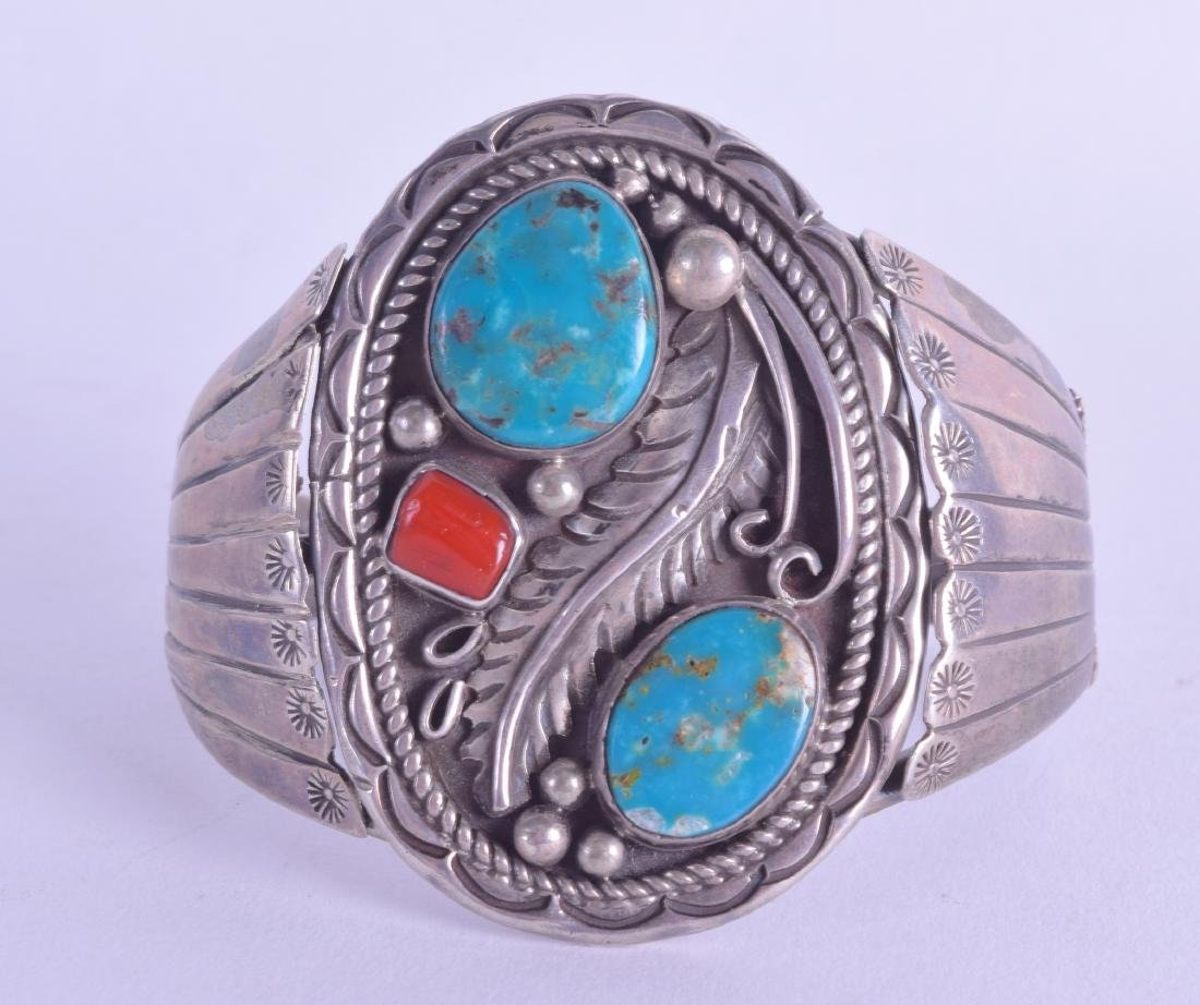AN EARLY 20TH CENTURY CHINESE TIBETAN SILVER BANGLE