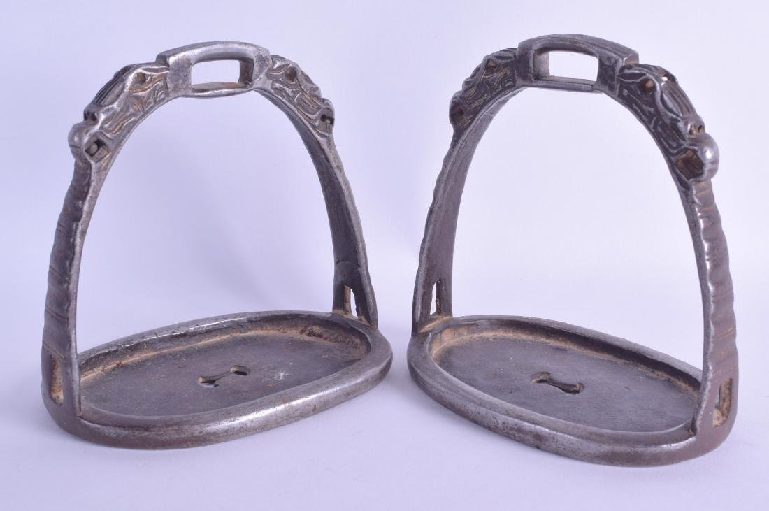 A PAIR OF CHINESE QING DYNASTY SILVERED BRONZE STIRRUPS