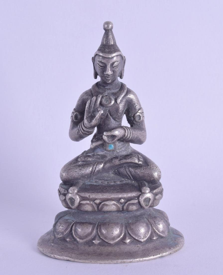 A SMALL 19TH CENTURY CHINESE TIBETAN SILVERED BRONZE