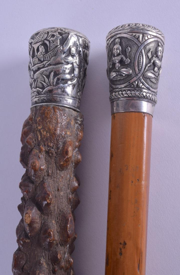A 19TH CENTURY CHINESE SILVER MOUNTED KNOBBLED WALKING