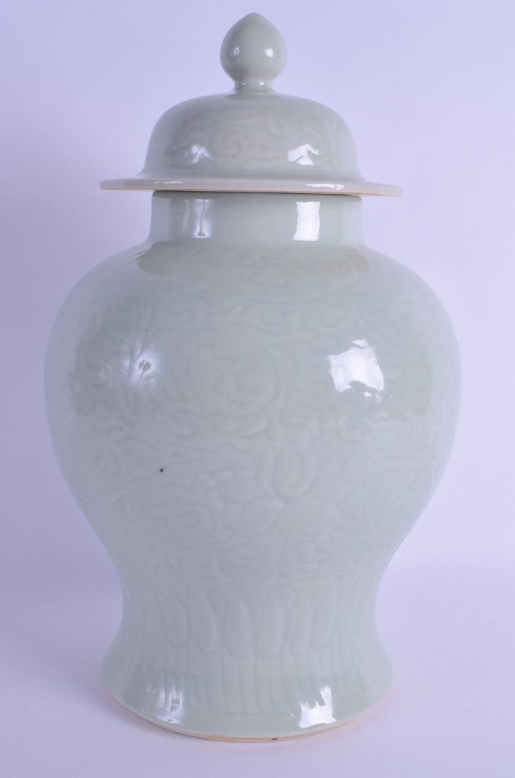 AN EARLY 20TH CENTURY CHINESE CELADON BALUSTER VASE AND