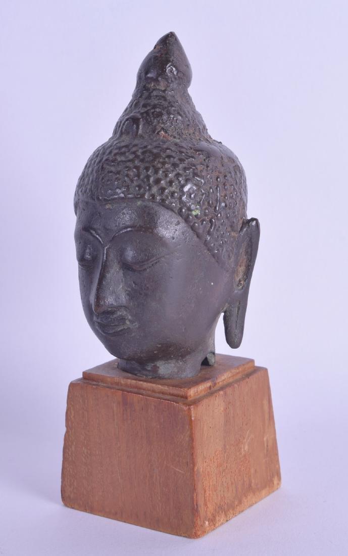 AN 18TH CENTURY THAI BRONZE BUDDHA HEAD modelled upon a