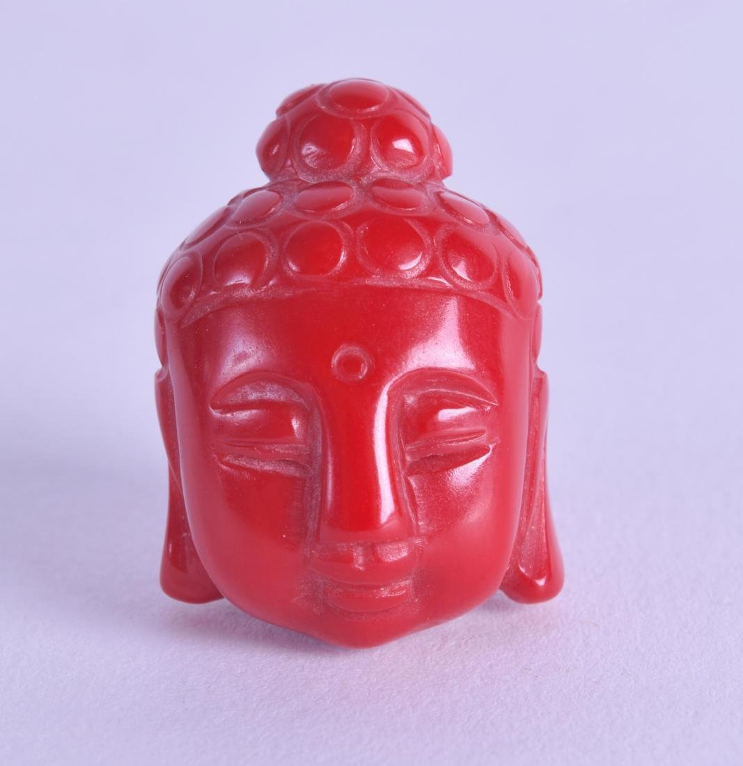AN EARLY 20TH CENTURY CHINESE CARVED RED CORAL BUDDHA
