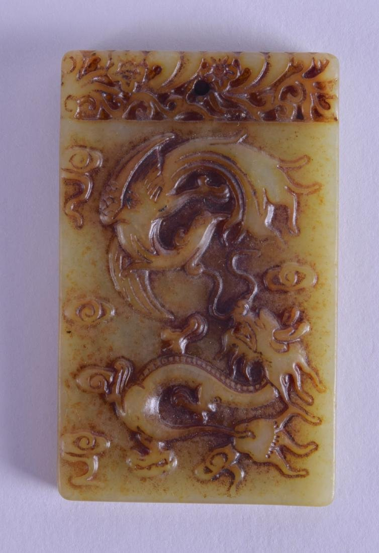 A CHINESE CARVED JADE TABLET carved with dragons and