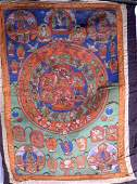 AN EARLY 20TH CENTURY CHINESE SINO TIBETAN THANGKA