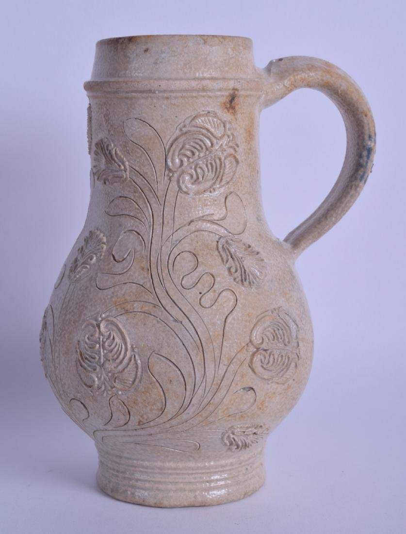 A RARE 17TH CENTURY GERMAN STONEWARE BELLARMINE JUG