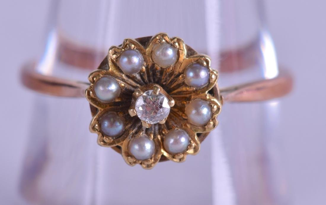 A VICTORIAN 18CT GOLD DIAMOND AND PEARL CLUSTER RING.