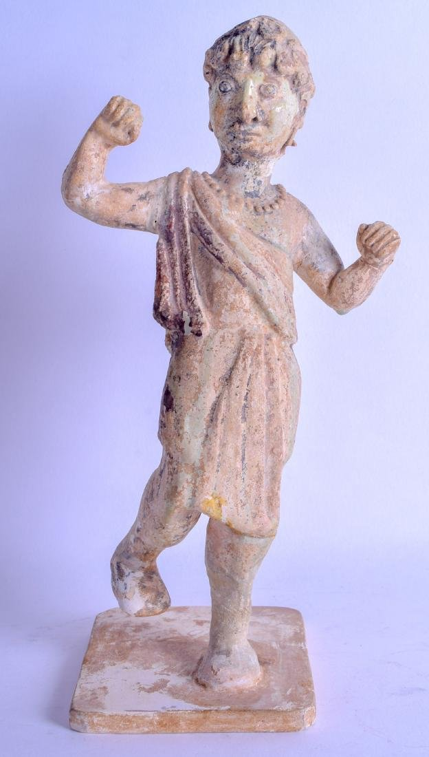 A VERY RARE CHINESE TANG DYNASTY POTTERY FIGURE OF A