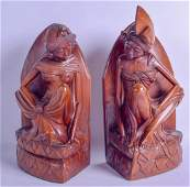 A LARGE PAIR OF SOUTH EAST ASIAN HARDWOOD BOOK ENDS