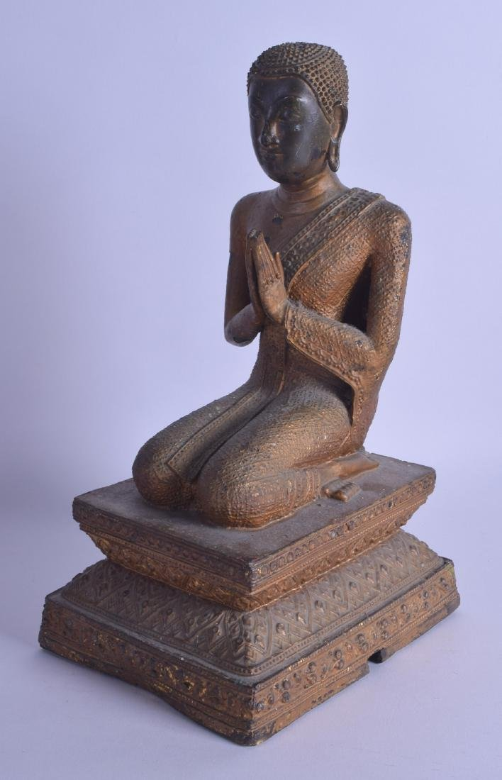 A 19TH CENTURY THAI BRONZE FIGURE OF A SEATED BUDDHA