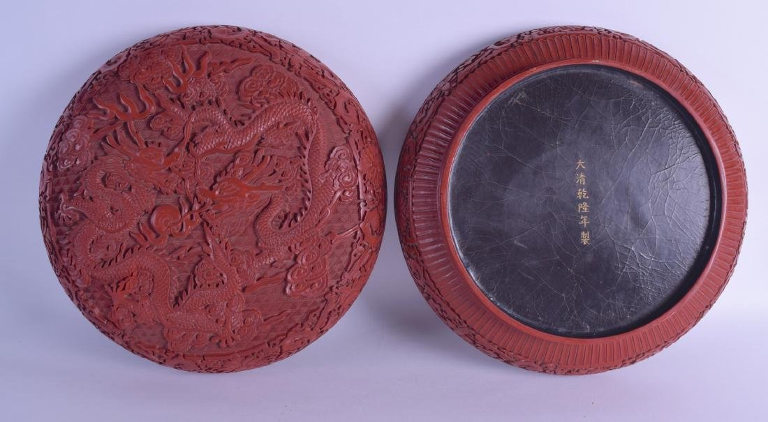 A FINE LARGE CHINESE CARVED CINNABAR LACQUER BOX AND