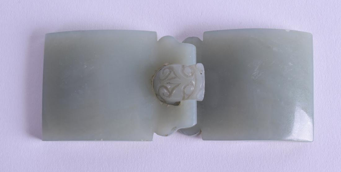 AN 18TH CENTURY CHINESE GREEN JADE BELT BUCKLE formed