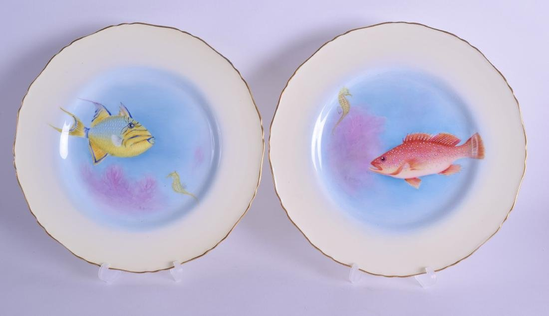 Royal Worcester pair of plates painted with fish and