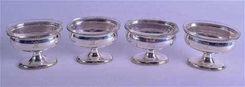 A SET OF FOUR GEORGE III SILVER CRESTED SALTS London