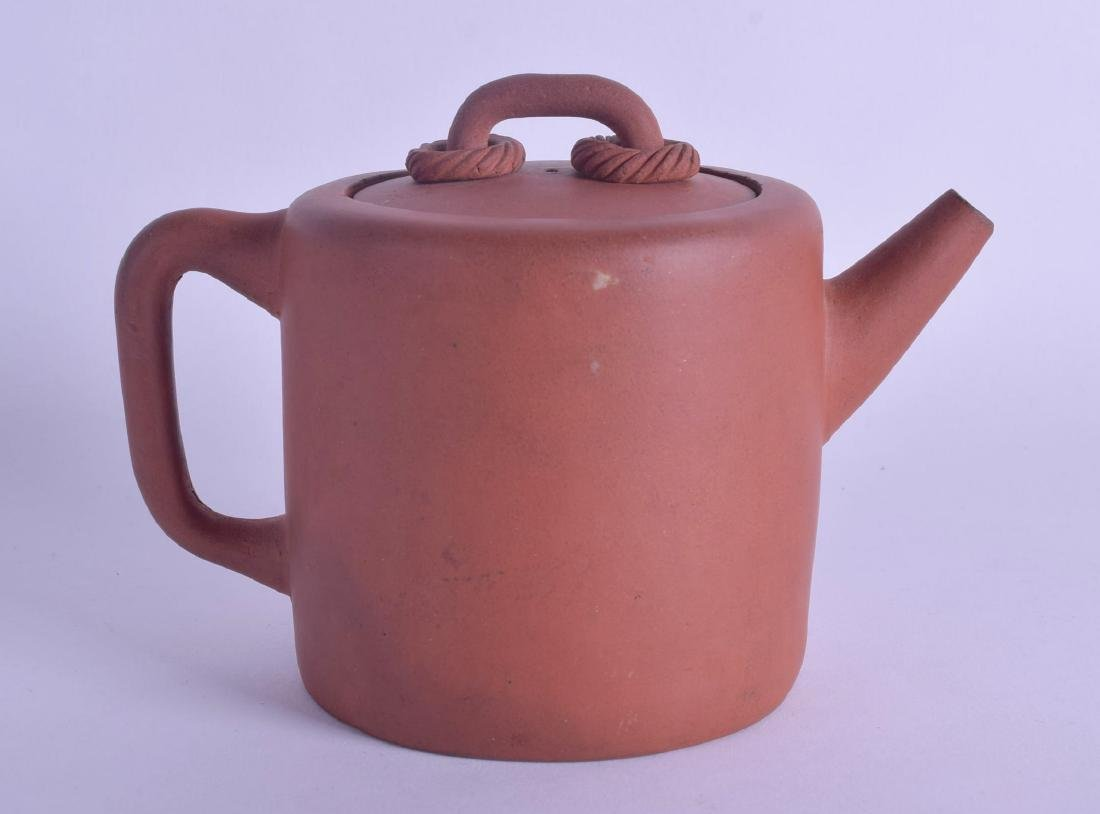A CHINESE QING DYNASTY YIXING POTTERY TEAPOT AND COVER