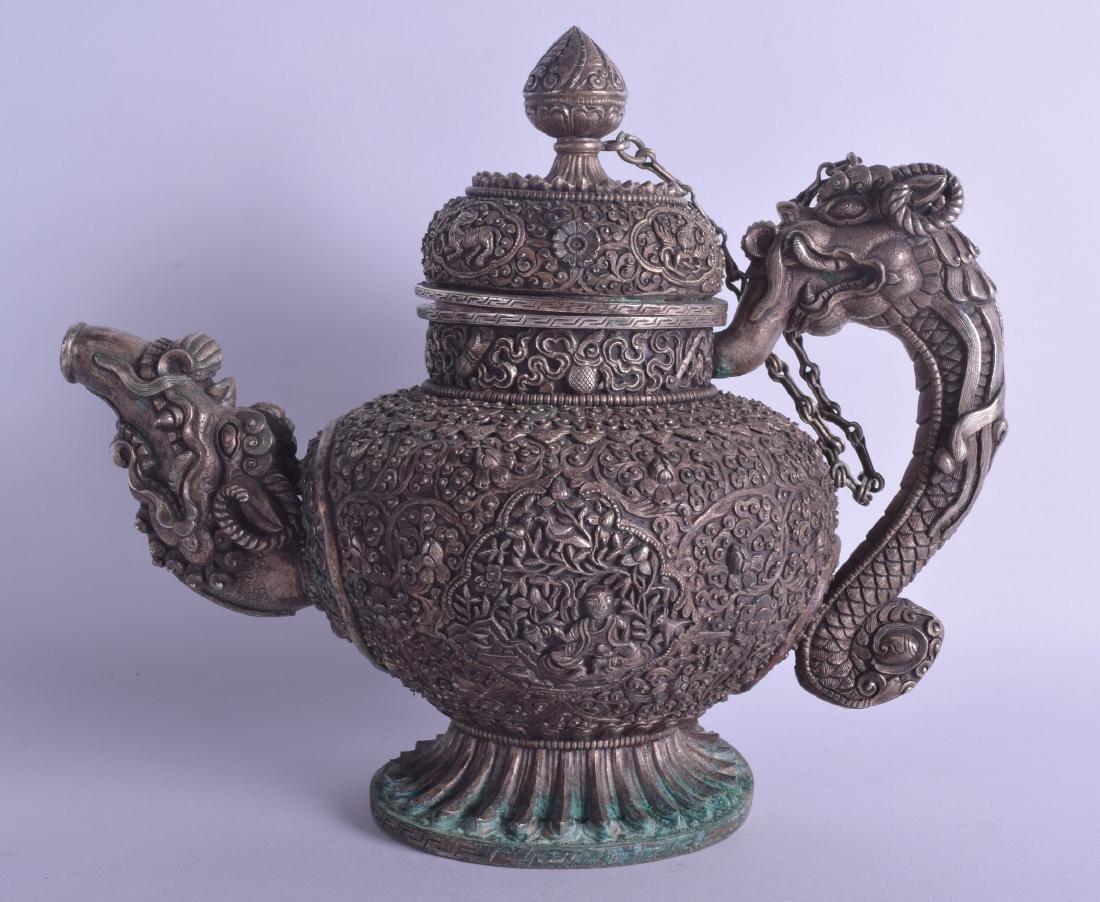A GOOD 19TH CENTURY CHINESE TIBETAN WHITE METAL TEAPOT
