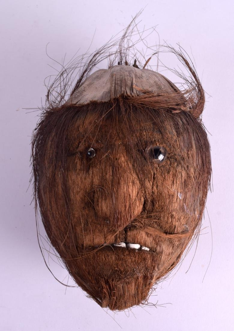 A VERY UNUSUAL TRIBAL CARVED COCONUT HEAD. 23 cm x 17