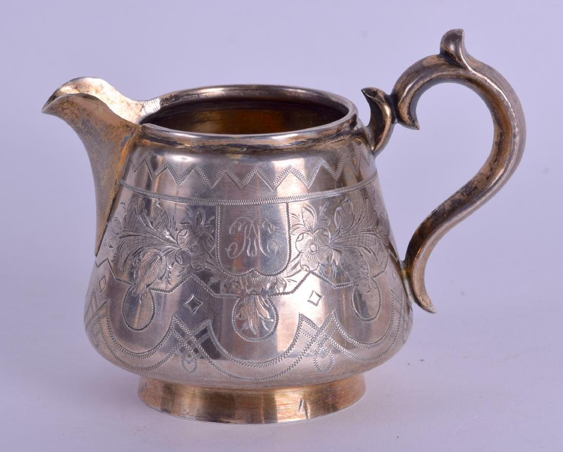 A 19TH CENTURY RUSSIAN ENGRAVED SILVER CREAM JUG