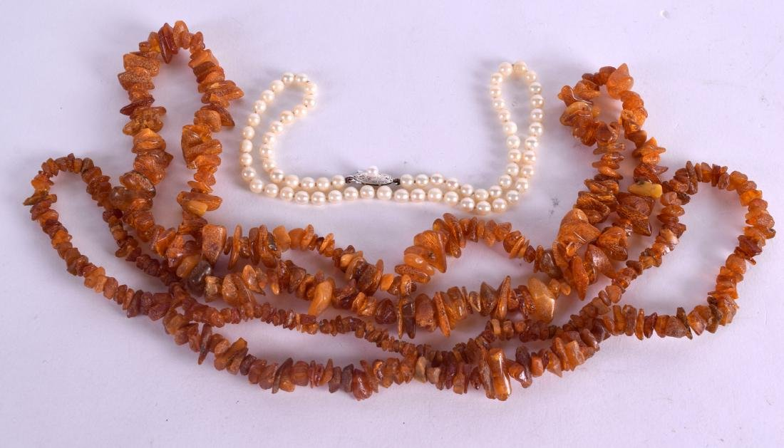 TWO ROWS OF NATURAL AMBER NECKLACES together with a 16