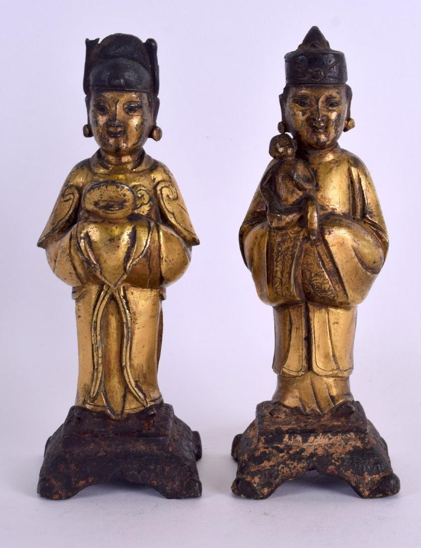 A RARE PAIR OF EARLY CHINESE GILT BRONZE FIGURES OF