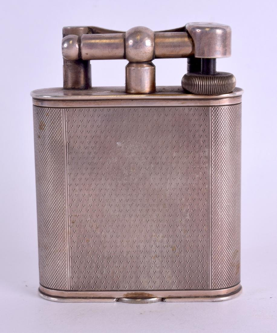 A RARE LARGE DUNHILL SILVER PLATED LIGHTER with engine
