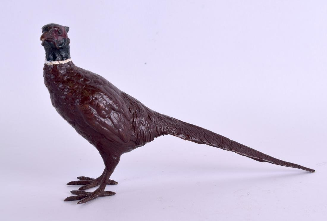 A COLD PAINTED BRONZE FIGURE OF A PHEASANT. 15 cm wide.