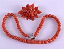 A GOOD EARLY 20TH CENTURY CARVED RED CORAL NECKLACE