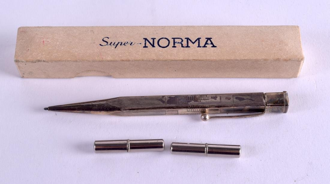 A STERLING SILVER PENCIL. 12 cm long.