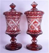 A LARGE PAIR OF BOHEMIAN RUBY FLASH VASES AND COVER