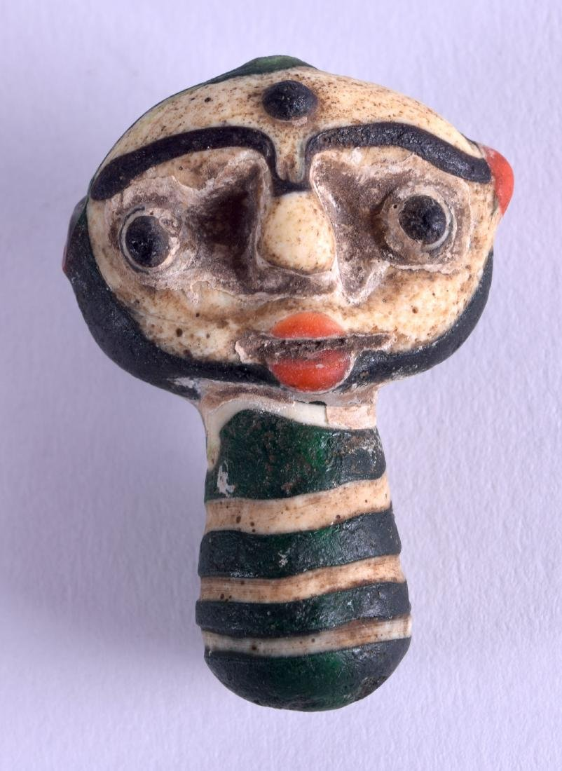 AN UNUSUAL EARLY CONTINENTAL GLASS AMULET in the form