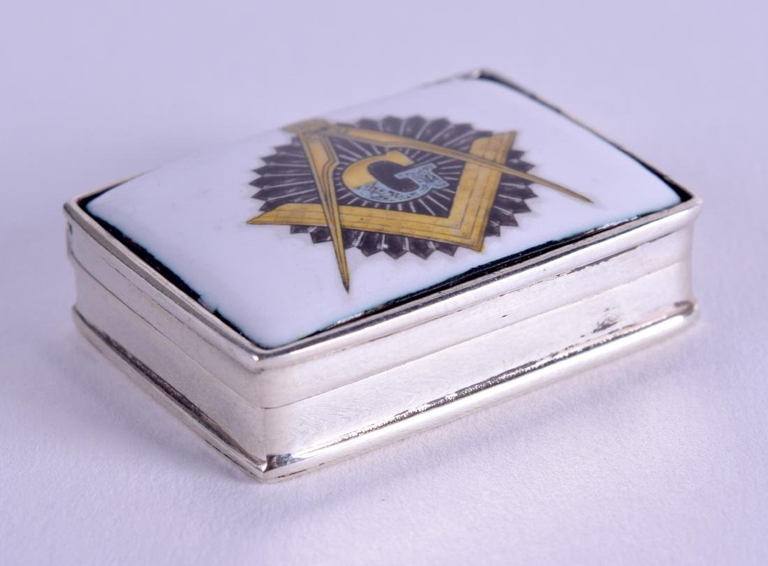A MASONIC SILVER PILL BOX. 2.5 cm wide.