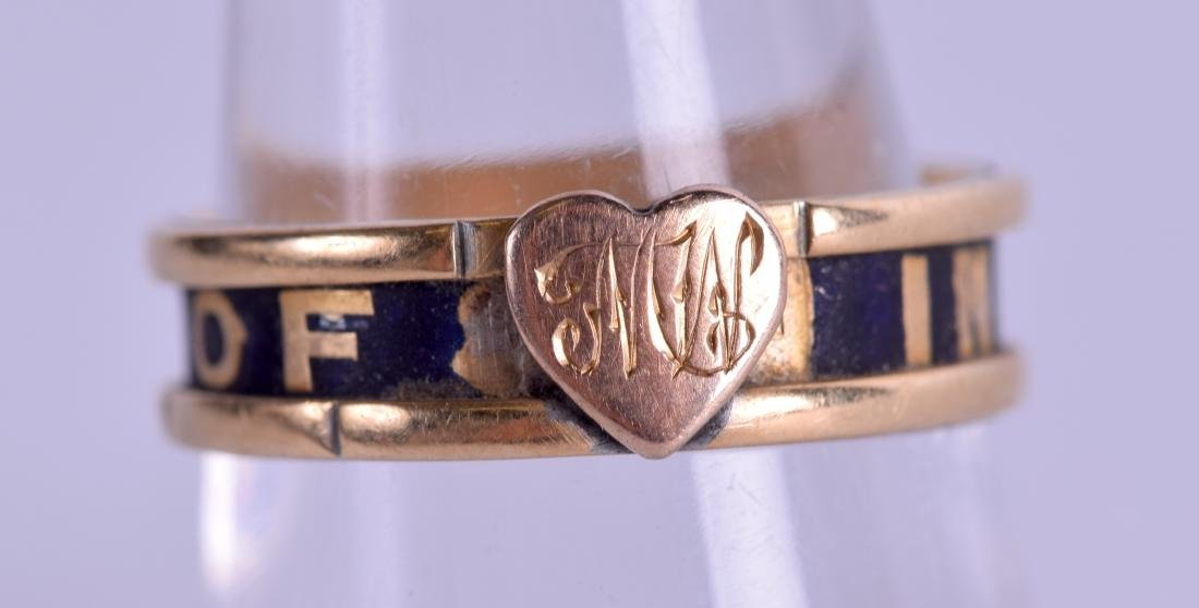 A MID VICTORIAN 18CT GOLD MOURNING RING. 3.6 grams.