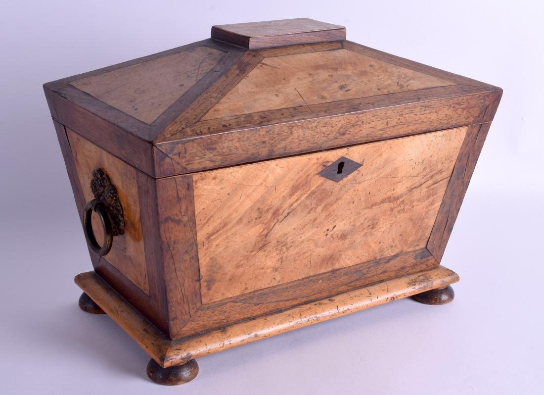 A VICTORIAN CARVED WALNUT TWIN DIVISION TEA CADDY with