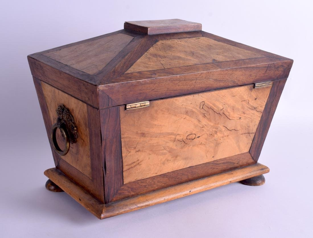 A VICTORIAN CARVED WALNUT TWIN DIVISION TEA CADDY with - 2