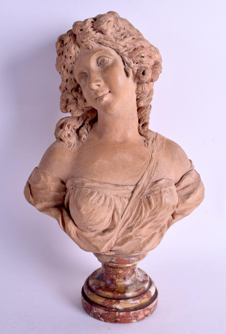 AN 18TH/19TH CENTURY FRENCH CARVED TERRACOTTA BUST